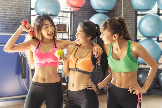 Portrait of group of happy young sport woman friends in gym