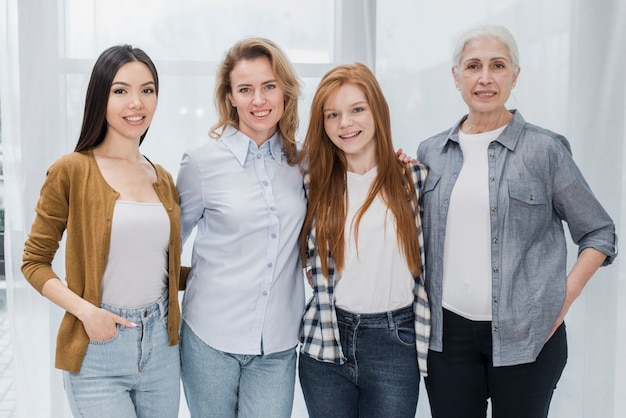 Portrait of group of women together smiling