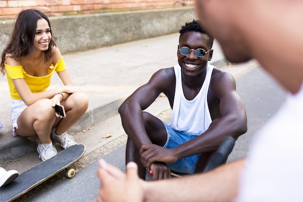 Portrait of group of young hipster friends talking in an urban area.
