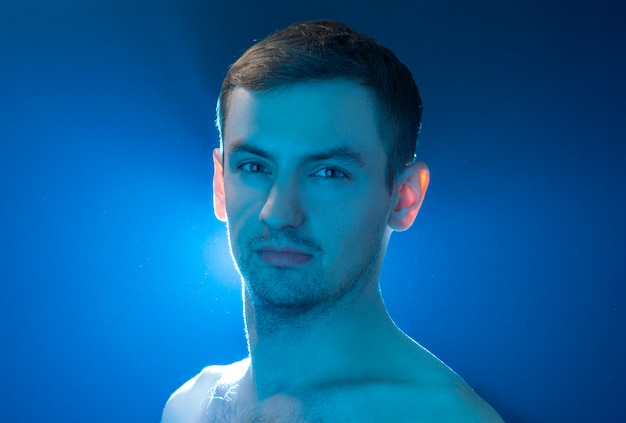 Portrait of a guy on a blue