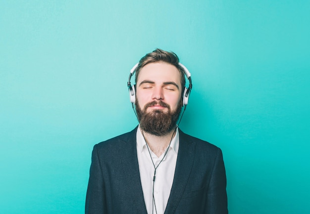 Portrait of a guy that is staying calm and listening to the music