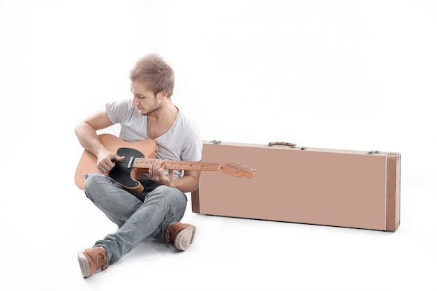 Portrait. guy with an acoustic guitar.isolated on white