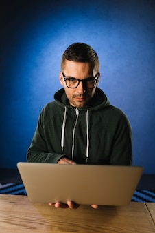 Portrait of a hacker with laptop
