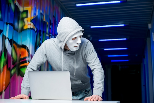 Portrait of hacker with mask