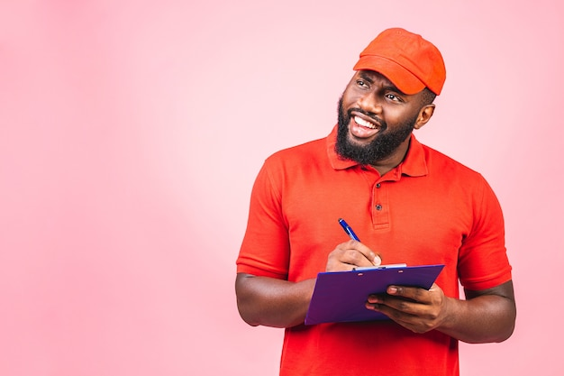 Portrait of handsome african american delivery man or courier