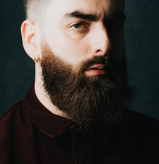 Portrait of a handsome bearded man, hipster style, serious, colorful, beauty and style concepts, lifestyle