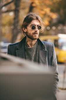 Portrait of a handsome bearded man in sunglasses