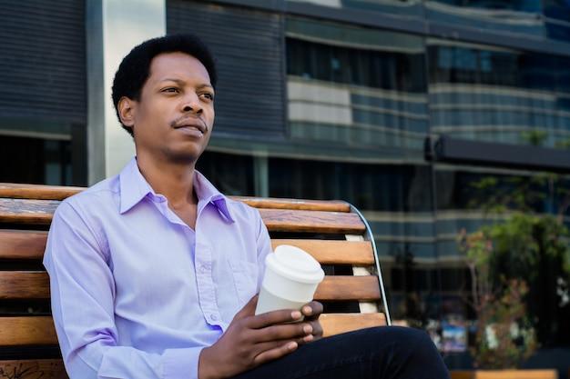 Portrait of an handsome businessman outdoor.