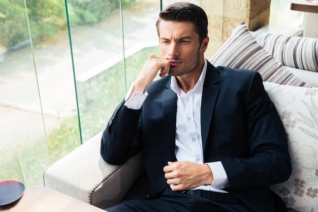 Portrait of a handsome businessman sitting in restaurant