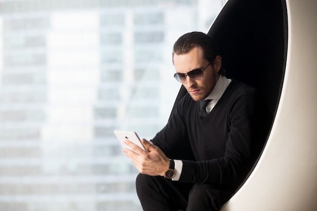 Portrait of handsome businessman in sunglasses