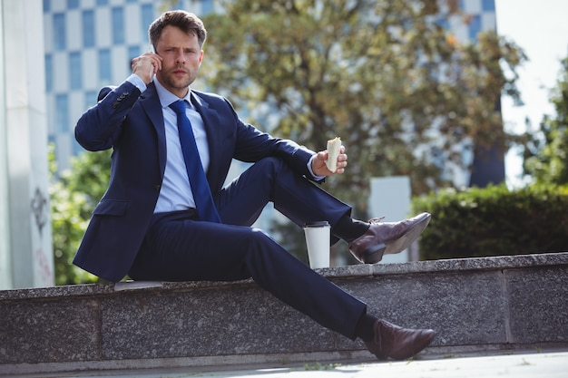 Portrait of handsome businessman talking on mobile phone
