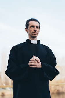 Portrait of handsome catholic priest or pastor with collar