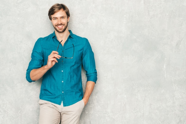 Portrait of handsome confident hipster lumbersexual businessman model wearing casual jeans shirt clothes.