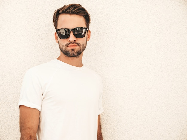 Portrait of handsome confident stylish hipster lambersexual model