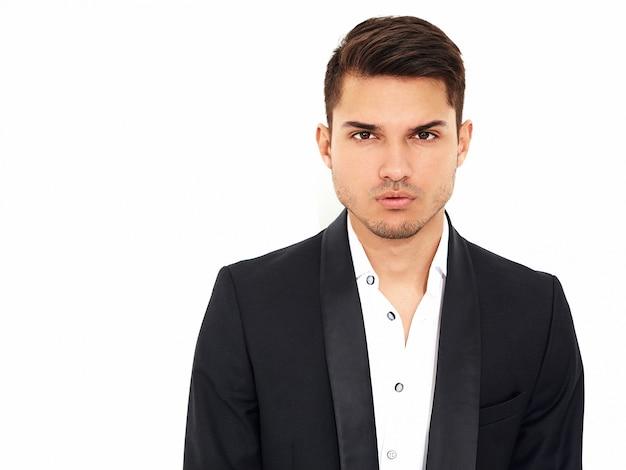 Portrait of handsome fashion stylish hipster  businessman model dressed in elegant black classic suit