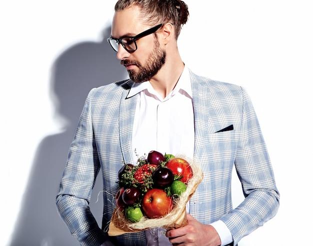 Portrait of handsome fashion stylish hipster businessman model man dressed in elegant light blue suit