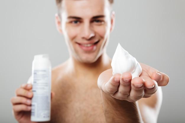 Portrait of a handsome half naked man showing