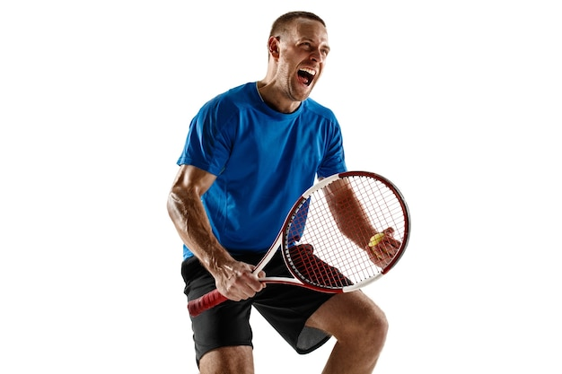 Portrait of a handsome male tennis player celebrating his success isolated on a white  wall. human emotions, winner, sport, victory concept