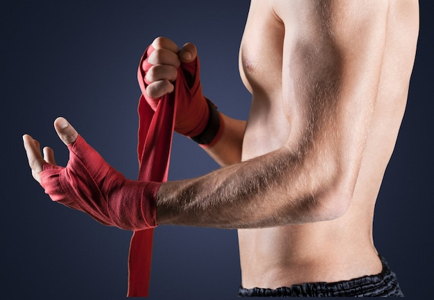 Portrait of a handsome man boxing isolated on  background