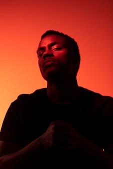 Portrait of handsome man over orange background