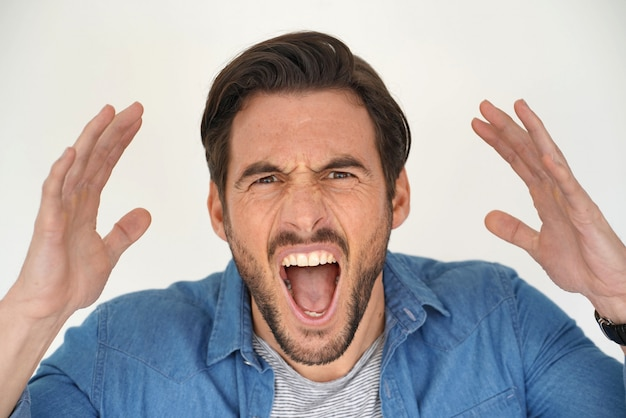 Portrait of handsome man shouting
