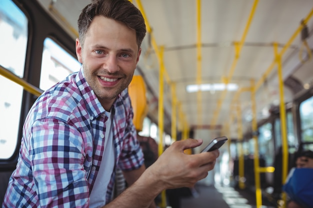 Portrait of handsome man using mobile phone