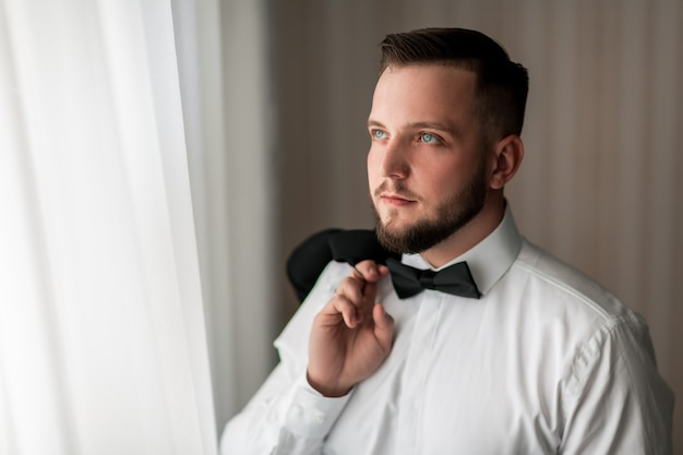 Portrait of a handsome man with a bow tie
