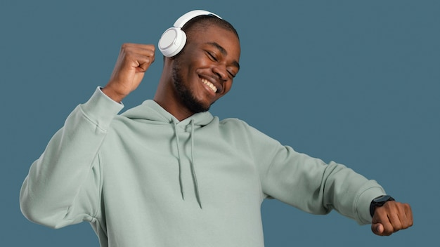 Portrait of handsome man with headphones dancing