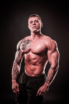 Portrait of a handsome muscular male bodybuilder.isolated on black background