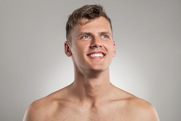 Portrait of handsome naked guy