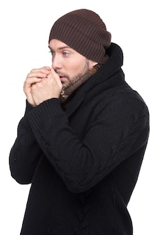 Portrait of handsome sick man in cap and scarf.