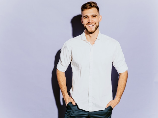 Portrait of handsome smiling hipster  businessman model wearing casual clothes.