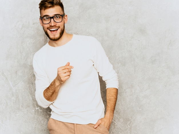 Portrait of handsome smiling hipster   businessman model wearing casual summer white clothes