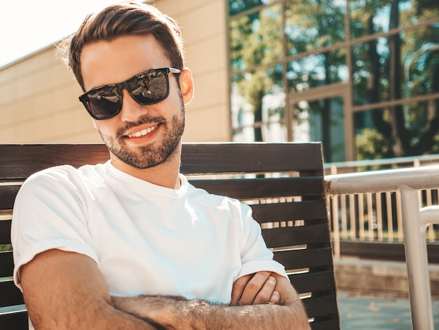 Portrait of handsome smiling stylish hipster lambersexual model