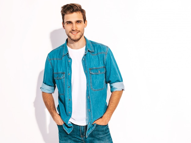 Portrait of handsome smiling stylish young man model dressed in jeans clothes. fashion man