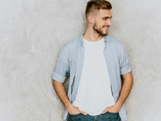 Portrait of handsome smiling young man model wearing casual shirt clothes. fashion stylish man posing