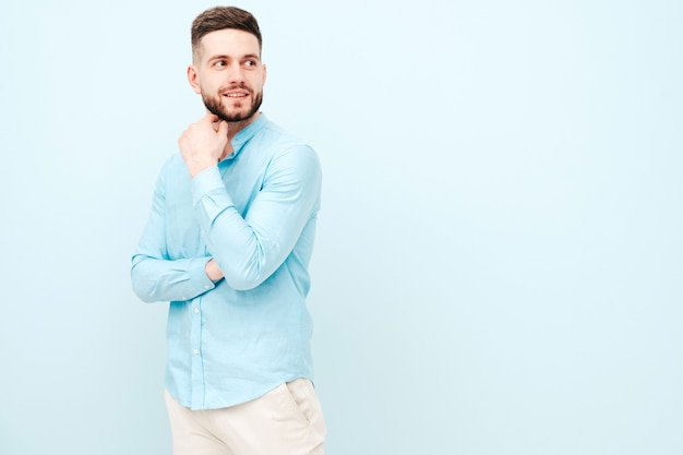 Portrait of handsome smiling young man wearing casual shirt and trousers