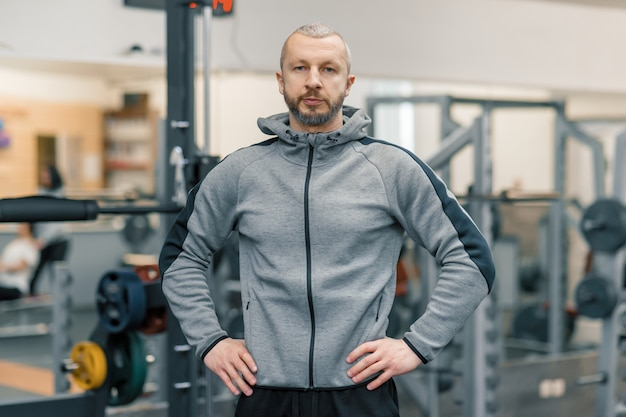 Portrait of handsome sporty man in gym