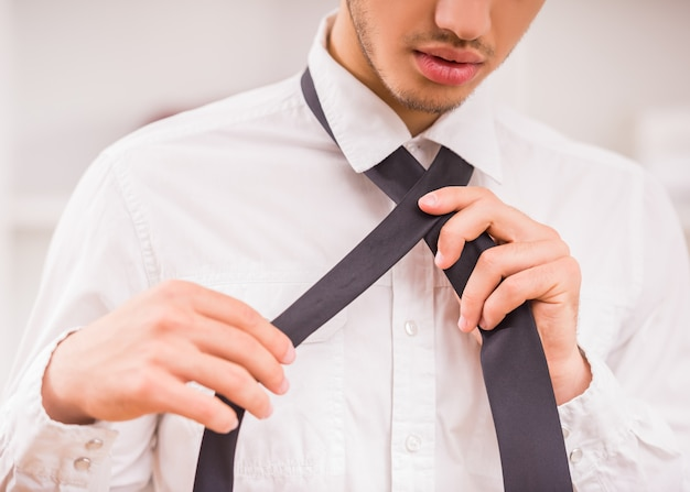 Portrait of handsome stylish young man wearing a tie.