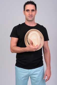Portrait of handsome tourist man on white