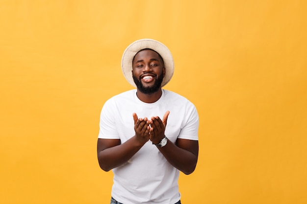 Portrait of handsome young african guy smiling in white t-shirt