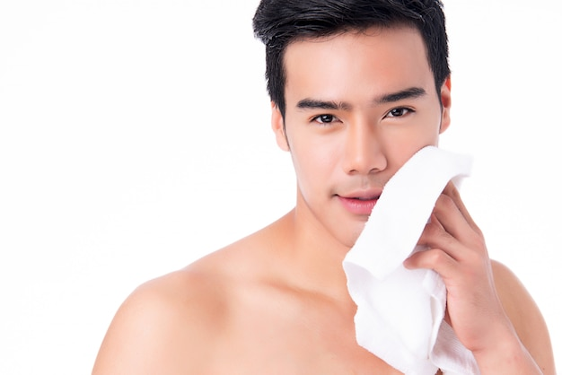 Portrait of handsome young asian man isolated. concept of men's health and beauty, self-care, body and skin care.