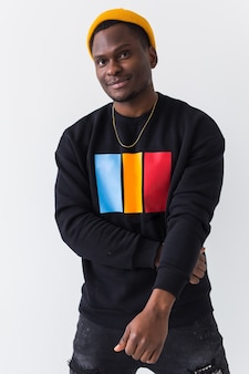 Portrait handsome young black man dressed in jeans and sweatshirt on white