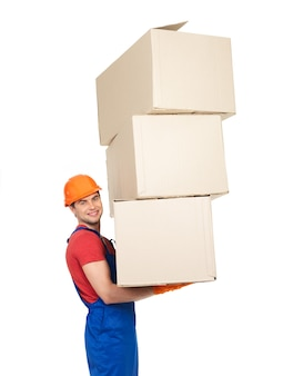 Portrait of handsome young delivery man with paper boxes isolated on white