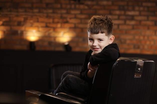 Portrait of a handsome young guy in the salon