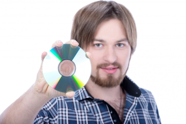 Portrait of a handsome young man holding cd.