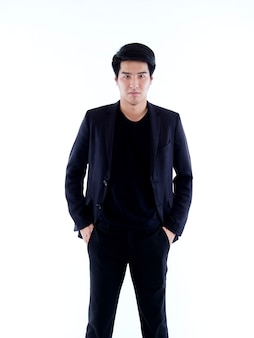 Portrait of handsome young man posing on white wall