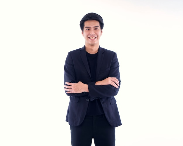 Portrait of handsome young man smiling on white wall
