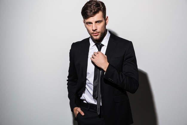 Portrait of a handsome young man in suit posing