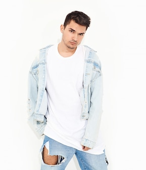 Portrait of handsome young model man dressed in jeans clothes posing. isolated